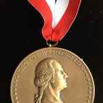 Photo image close up of the George Washington Book Prize medal won by Stephen Brumwell in 2013 for 'George Washington: Gentleman Warrior'.